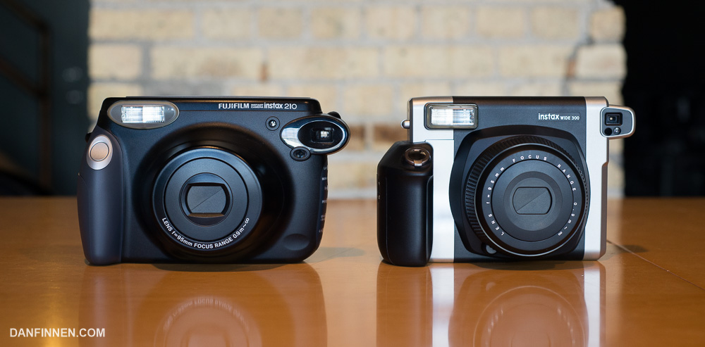 The Fuji Instax Wide 300 (on the left) is a much better camera than the outgoing 210 (right), but it's kind of like the choice between an '80s era VCR or a '90s one.