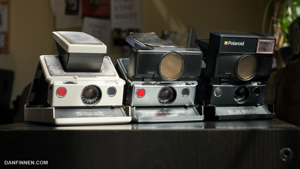 Over the decades, the SLR type Land Cameras evolved to include autofocus  and flash units. 92d4d552ab7c